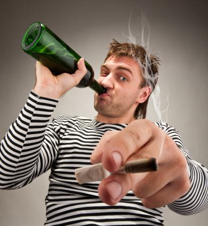 bizarre: Drunk bizarre sailor with bottle and cigarette