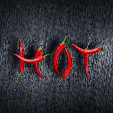 cayenne: Hot message made of chili peppers against scratched metal background