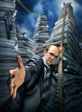 Serious businessman inviting you to climbing up the pile of paperwork