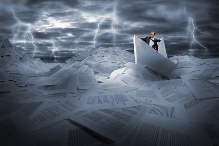 storm clouds: Lost alone businessman sailing in stormy papers sea Stock Photo