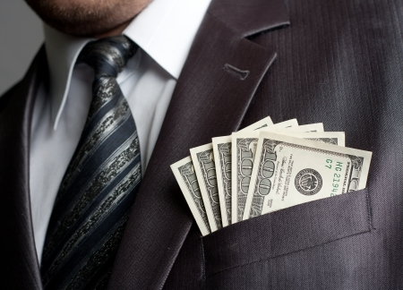 Formal weared businessman with earned money in suit pocket Stock Photo - 18055353