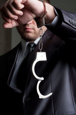 Freedom - businessman with unlocked handcuffs on hand photo