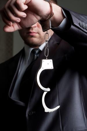 unlocked: Freedom - businessman with unlocked handcuffs on hand