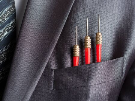 Business concept - three red darts in businessman suit pocket Stock Photo - 18055532