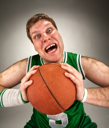 Portrait of bizarre basketball player with ball Stock Photo - 18035205