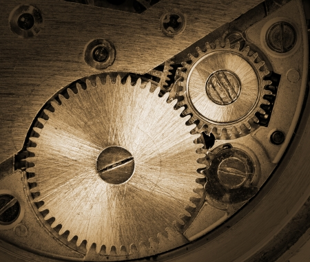 Close-up of old clock mechanism with gears photo
