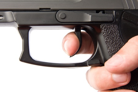 Pushing the handgun trigger Stock Photo - 18032989