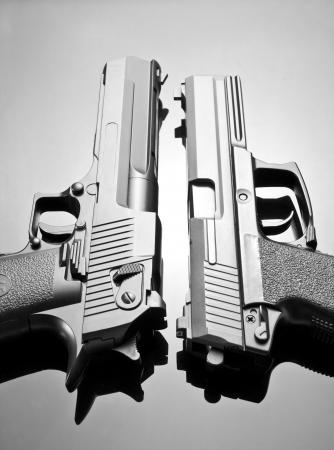 black grip: Two handguns. Desert Eagle and M23 Double Eagle