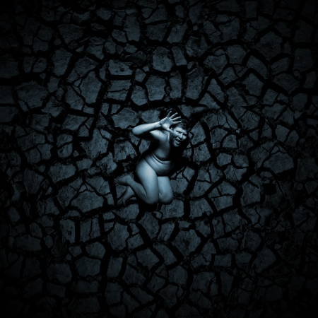 Scared naked man on the cracked soil Stock Photo - 18055367