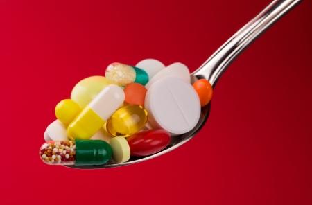 Spoon full of vaus pills. Closeup view Stock Photo - 18033313