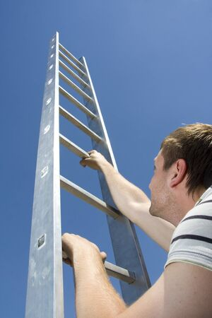 Man climbing ladder photo