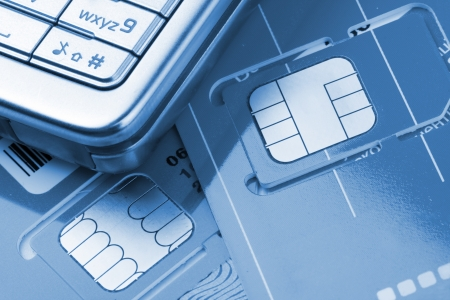 sim: Close-up of mobile phone with sim cards. Toned in blue Stock Photo