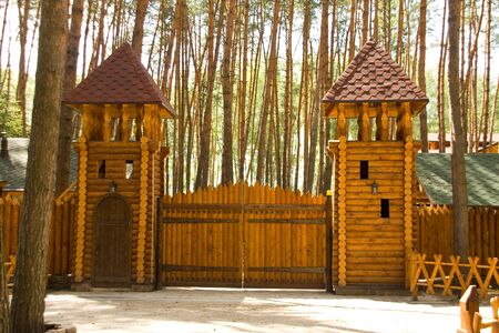 Big wood gates and two towers in forest Stock Photo - 18055424