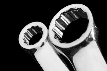 forkwrench: Close-up of chrome wrenches isolated on black Stock Photo