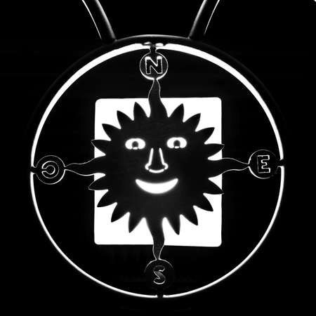 navigational light: Silhouette of sun compass. In BW Stock Photo