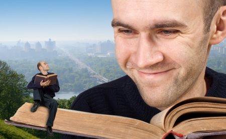 teaching adult: Big and small men reading the bible Stock Photo