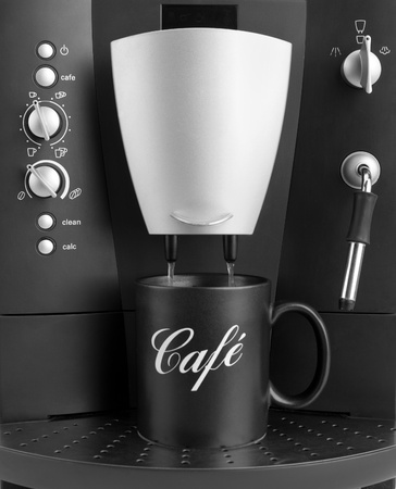 Front view of coffee machine with black cup