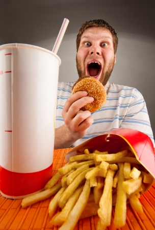 Portrait of expressive man eating fast food Stock Photo - 18055805
