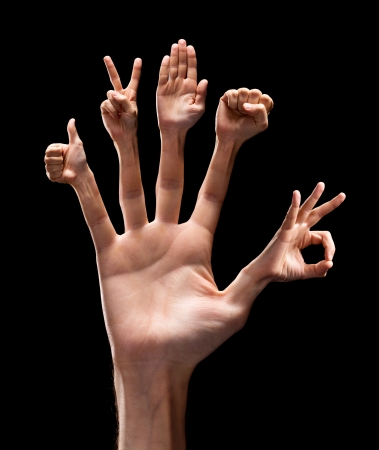 hands raised: Various hand signs on each finger. Isolated on black