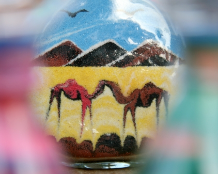 east africa: Two camels in Egypt desert. Sand in glass bottle