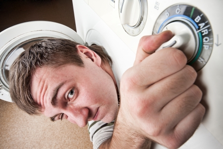 Close-up of surprised man inside washing machine Stock Photo - 18055148