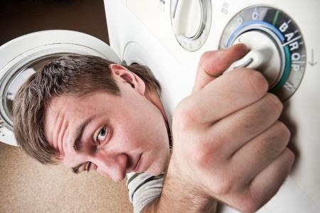 Close-up of surprised man inside washing machine Stock Photo - 18055148