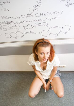 Tired chemist student in classroom photo