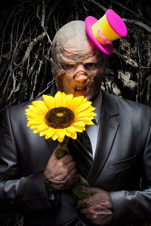 Sad monster in business suit with sunflower photo