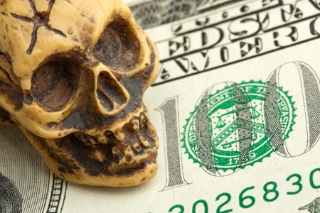 ghoulish: Bankruptcy concept. Human skull on money banknote