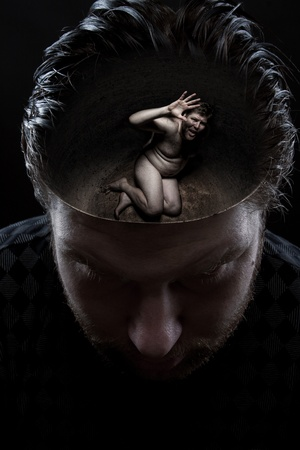 Vulnerability concept. Scared naked small man inside own head Stock Photo - 18035247