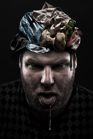 blockhead: Ignorance concept. Heap of garbage inside silly man head