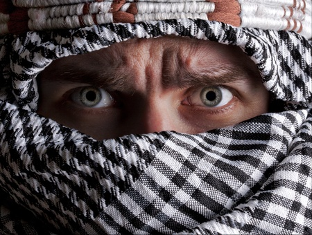 Portrait of scared middle eastern man looking to you photo