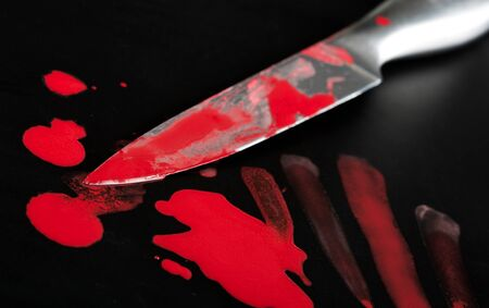 Close-up of knife in blood