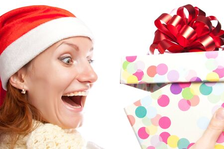 Happy surprised woman opening christmas gift. Isolated on white Stock Photo - 18072621