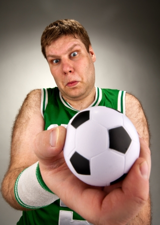 socker: Portrait of surprised basketball player with football