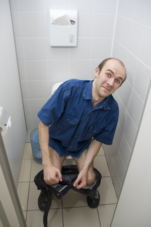 Scared man in toilet photo