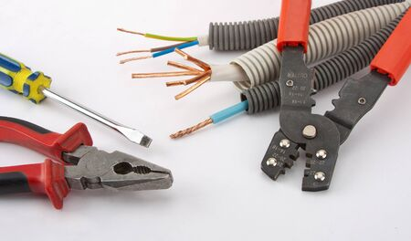 Electricians tools. Pliers, cables, cutter and screwdriver
