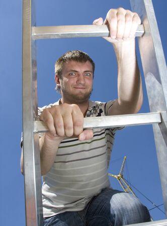 climbing ladder: Man climbing ladder