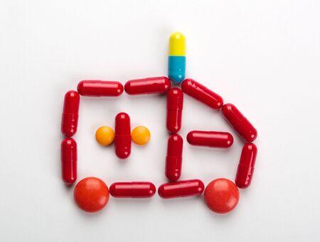 Ambulance car symbol made from colorful medicines photo