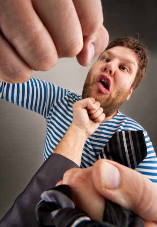 outrage: Social confrontation - bandit and businessman punching each other