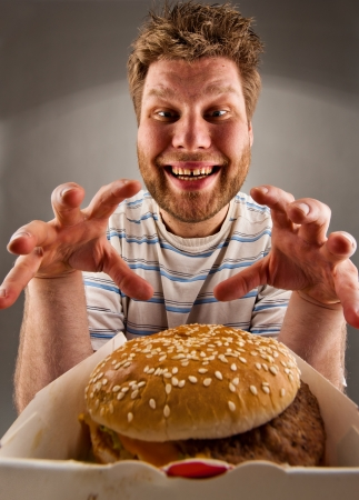 1 man: Portrait of happy man preparing to eat burger Stock Photo