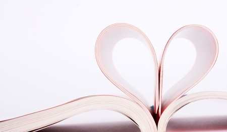 Close-up of book pages folded into a heart shape photo