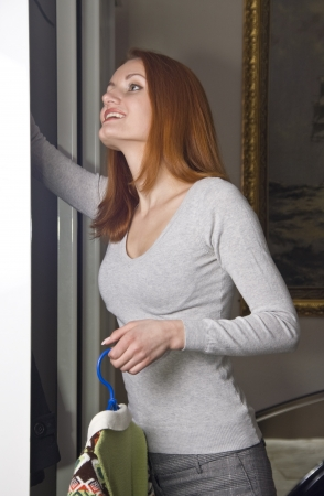 Woman near the closet choosing what to wear photo