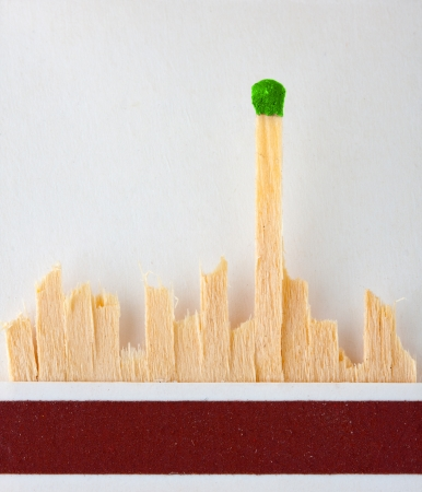 The last green match standing in matchbook Stock Photo - 18073311