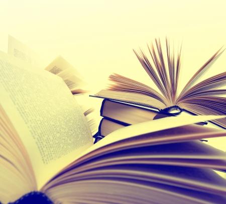 toned image: Many hardcover books. Toned image