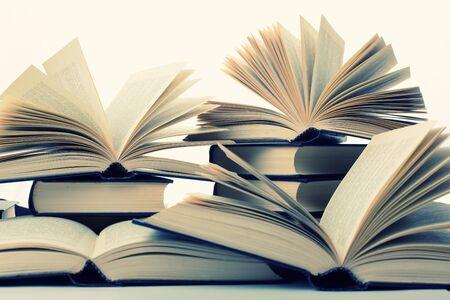 hardcovers: Many hardcover books. Toned image