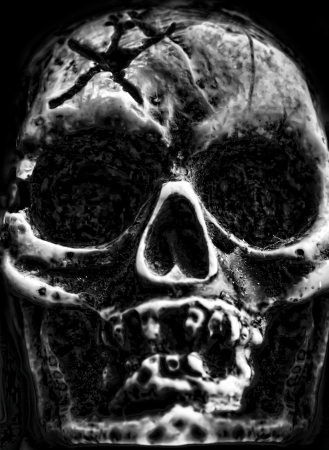 ghoulish: Old scary human skull in the dark Stock Photo