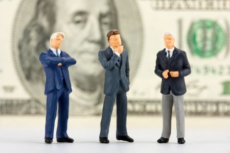 Miniature figurines of successful business team with $100 banknote on background Stock Photo - 18073303