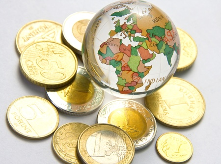 european exchange: World globe and different coins Stock Photo