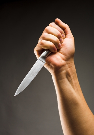 murdering: Close-up of hand with knife Stock Photo